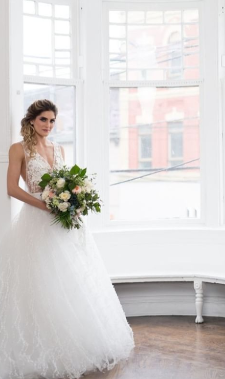 bride in front of a window